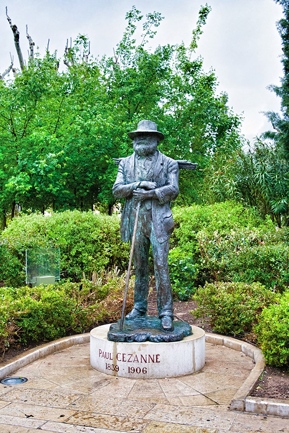 The bronze statue of Cézanne stands just outside the Tourist Office